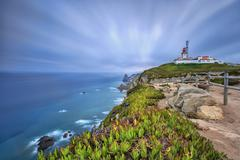 Sunrise on the cape and lighthouse of Cabo da Roca overlooking the Atlantic Stock Photos