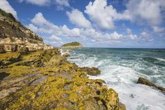 The waves of the Caribbean Sea crashing on the cliffs, Half Moon Bay, Antigua Stock Photos