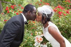 A moment before a passion kiss between pretty wedding couple Stock Photos