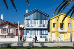 Colourful stripes decorate traditional beach house style on houses in Costa Stock Photos