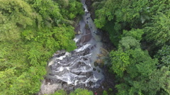 Descending Through Bali Indonesia Jungle Towards Waterfall Stock Footage