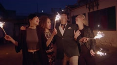 Happy young people celebrating new years eve Stock Footage