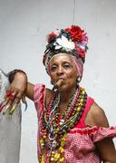 Woman smoking cigar, old Havana, Cuba, West Indies, Caribbean, Central America Stock Photos