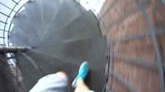 Man Walking Down the Corkscrew Staircase Stock Footage