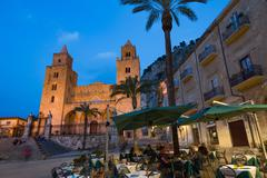 People dining in Piazza Duomo in front of the Norman Cathedral of Cefalu Stock Photos
