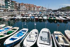 Traditional fishing boats moored in the harbour in Lekeitio, Basque Country Stock Photos