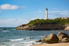 Rocks on the sandy beach and the lighthouse in Biarritz, Pyrenees Atlantiques, Stock Photos