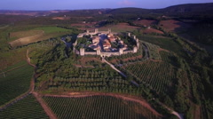 Aerial view of Monteriggioni with vineyards Tuscany Italy Stock Footage