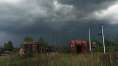 Storm timelapse over the abandoned train wagons Stock Footage