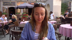 Woman Using Nasal Spray in Outdoor Cafe Stock Footage