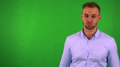 Young handsome business man disagrees - green screen - studio Stock Footage
