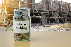 Money saving for House  building in the glass bottle Stock Photos