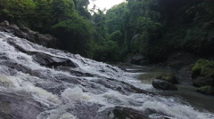 Flying Low Over Bali Indonesia Waterfall Through Jungle Stock Footage