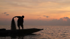Silhouette of Fishermen fishing in the lake at the sunrise time. Stock Footage