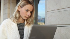 Woman online shopping via laptop in cafe Stock Footage