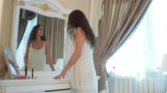 Girl dancing in the bedroom in front of the mirror Stock Footage