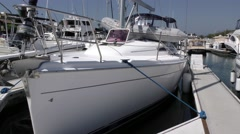 Port side view of sail yacht ready to leave dock with dingy on deck .mp4 Stock Footage
