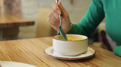 Attractive woman eating tasty soup in cafe Stock Footage