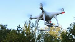 Quadrocopter Phantom 4 drone flies over blue sky. Stock Footage