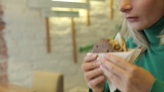 Young Female Eating Vegetarian Burger in Cafe Stock Footage