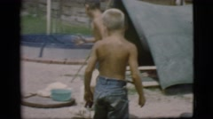 1968: two young boys boiling water over a campfire COTTONWOOD, ARIZONA Stock Footage