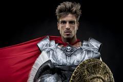 Centurion or Roman warrior with iron armor, military helmet with horsehair an Stock Photos