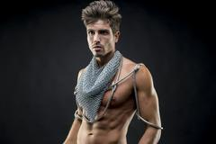 Fitness, attractive naked man with abdominal, chain mesh medieval neck with m Stock Photos