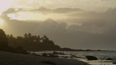 4K:Tropical Coastline Lock Off With Waves Crashing and Sun Setting Stock Footage