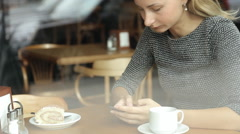 Woman hands texting on smartphone during breakfast in cafe Stock Footage