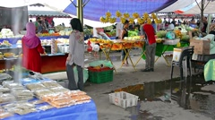 Local vendors selling fruit at the outdoor public market in Kota Kinabalu Stock Footage