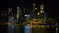 Singapore's dramatic, night time skyline over Marina Bay Stock Footage