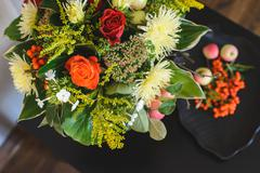 Autumn composition of bouquet and apples with rowan Stock Photos