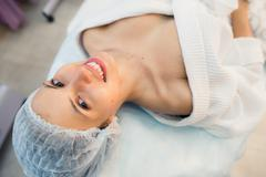Beautiful patient woman smile lying on bed in surgery room hospital Kuvituskuvat