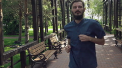 Guy wearing in casual blue shirt rear back view runs fast Stock Footage