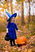 Little girl on Halloween trick or treat Stock Photos