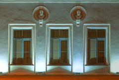 Windows on night facade of apartment building Stock Photos