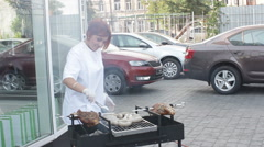 ODESSA, UKRAINE, 28th of June (2014) the cook prepares a barbecue for guests Stock Footage