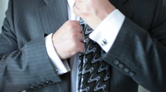 Businessman corrects tie Stock Footage