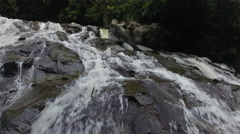 Rising Above Bali Indonesia Waterfall Through Jungle Stock Footage