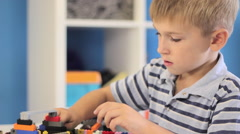 Child playing with a construction toy set Stock Footage