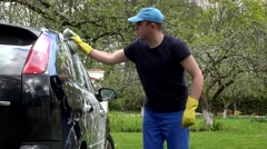 Car washing by hand using a foam preparation for polishing Stock Footage