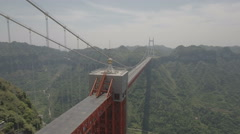 Panning aerial shot of the massive Aizhai suspension bridge in China Stock Footage