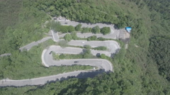 Aerial drone shot of hairpin bend zigzag road in central China Stock Footage