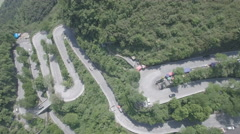 Aerial view, twists and turns, Aizhai winding mountain road in central China Stock Footage