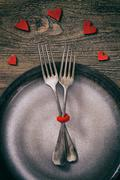 Valentines day dinner with table setting in rustic wood Stock Photos
