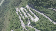 Aerial drone shot of winding mountain road in China Stock Footage