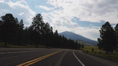 Driving Highway 180 Into Kendrick Park With Humphreys Peak- Time Lapse 15s Stock Footage