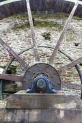Axle and spokes of water wheel. Stock Photos