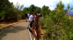 Visitors looking at the Mather Point at the Grand Canyon Park. Stock Footage