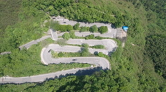 Aerial drone shot of hairpin zigzag road in central China Stock Footage
